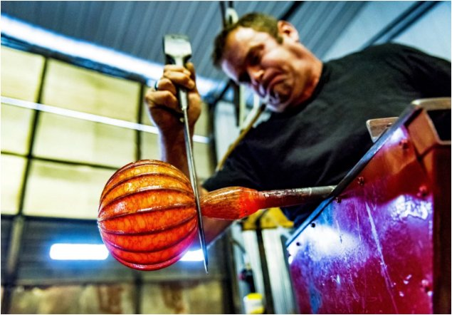Glass artist Jack Pine works on one of his famous glass pumpkins