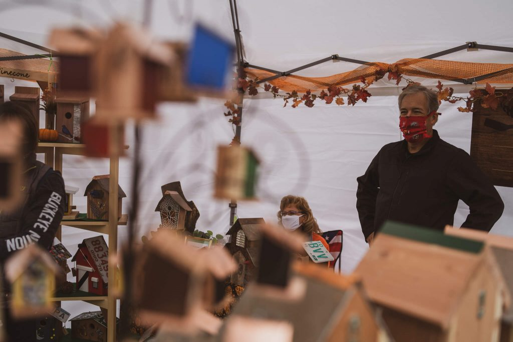 Artists display their wares in a tent