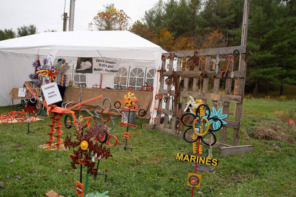 Artistic metal sculptures are featured by one vendor at the Glass Pumpkin Festival