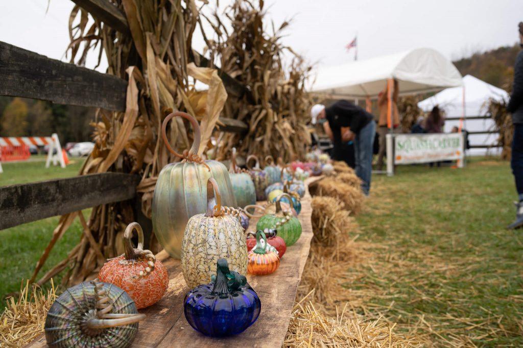 A festive, fall arrangement of Jack Pine glass pumpkins