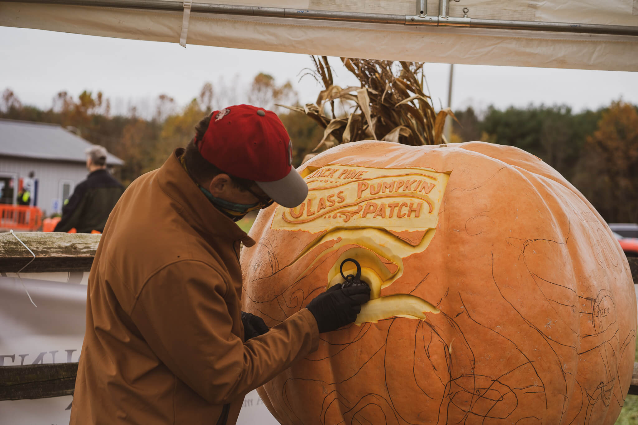 A pumpking carver working on an elaboarte design
